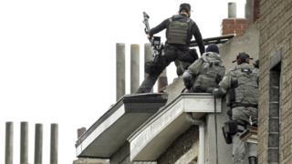 Belgian special forces raided a house in Molenbeek in their search for one of the Paris attackers