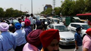 Taxi drivers shout slogans as they block a road during a protest in New Delhi on May 2
