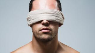 A man blindfolded