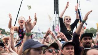 Festival-goers attend Glastonbury