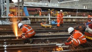 Railway workers completing engineering work