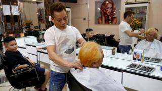 The Hanoi barber offering free haircuts in the style of US president Donald Trump and North Korean Kim Jong-un.