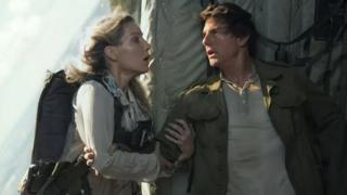 Annabelle Wallis and Tom Cruise scream before Annabelle evacuates the plane