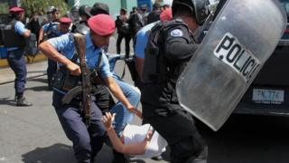 Nicaraguan riot police detain a protester demanding the government release opposition activists, in Managua on March 16, 2019