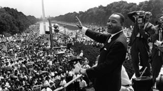 US civil rights leader Martin Luther King waving from the steps of the Lincoln Memorial to supporters on the Mall in Washington, DC in 1963