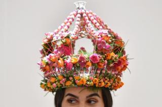 A model wears a flower crown by Dean Sharpe's Floral Studio
