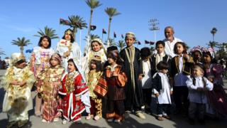 """Libyans dressed in their country""""s traditional clothing attend the national day of the Libyan costume at the Martyrs Square in the capital Tripoli, on March 13, 2018"""