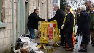 Prince Andrew shaking a flood-hit homeowner's hand