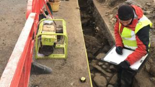 Archaeologist Steven Birch recording remains of chapel in Kingussie