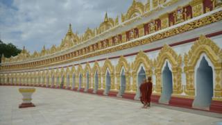 Monks outside a pagoda on the outskirts of Mandalay