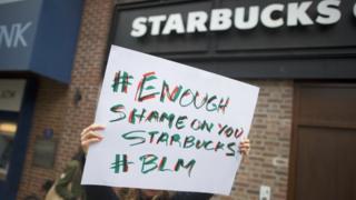 Protestors demonstrate outside a Starbucks in Philadelphia.