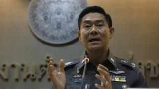 National police deputy spokesman Col Songpol Wattanachai addresses a press conference in Bangkok, Thailand, Friday, 4 Dec