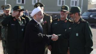 Iranian President Hassan Rouhani attends an armed forces parade in Tehran