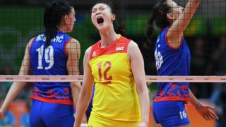 Chinese women's volleyball team score a point