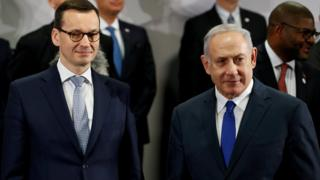 """Poland""""s Prime Minister Mateusz Morawiecki and Israel""""s Prime Minister Benjamin Netanyahu look on during the Middle East summit in Warsaw, Poland, February 14, 2019"""