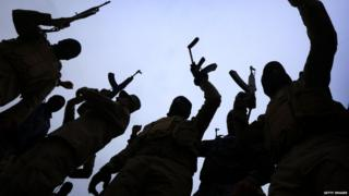 Silhouette of militant fighters