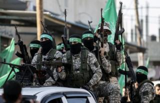 Members of the Ezzedine al-Qassam Brigades, the military wing of the Palestinian Islamist movement Hamas, take part in a rally marking the 29th anniversary of the creation of the movement on December 16, 2016.
