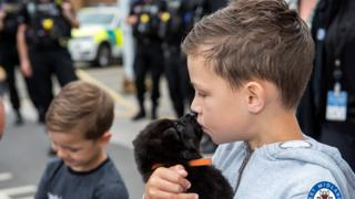 ai marketing 5g smartphones nanotechnology developments Oscar with a police puppy