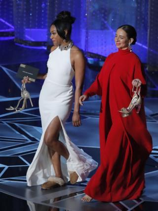 Tiffany Haddish (L) and Maya Rudolph take the stage
