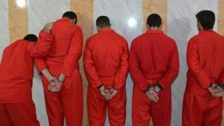Picture from behind of five of those condemned