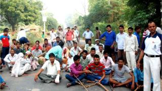 Enraged against the incident at Sunped village, youths blocked road demanding action against the accused, in Faridabad district on Tuesday.