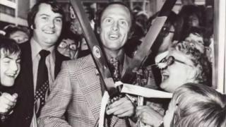 Geoff Boycott with the giant scissors