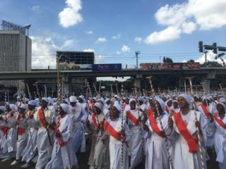 Ethiopians in white robes take part in the celebrations