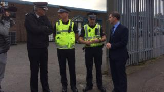 Justice Secretary Michael Matheson and police officers