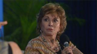 Isabel Allende holds the microphone