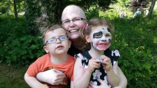 Rebecca Wilkinson with her two children Connie and Freddie during her chemo treatment which also left her needing eyebrow tattoos.