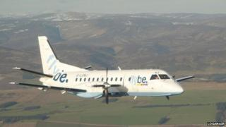 Loganair aircraft flying under Flybe livery