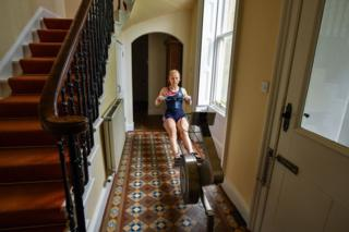 healthy fod for babies An athlete using a rowing machine in a hallway