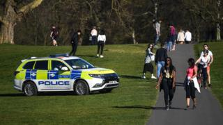 A police car patrolling Greenwich Park in London in April