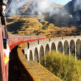 The Jacobite Express crossing the Glenfinnan Viaduct at Glenfinnan