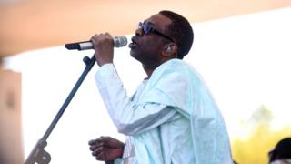Senegalese singer Youssou Ndour performs during the inauguration of the Farafenni Bridge on 21 January 2019 in Farafenni