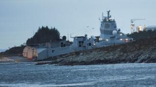 The Norwegian frigate KNM Helge Ingstad takes on water after colliding with the tanker Sola TS in the waters off Oygarden, Norway, 8 November 2018