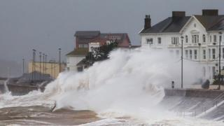 Waves crashing onto the promenade on Exmouth seafront