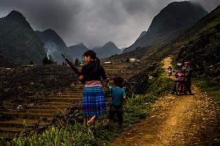 Children make their way through the landscape