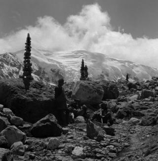 A black and white picture showing cairns at a rest stop on the way up to the Kharta Glacier