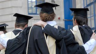 Graduates in robes and mortarboards outside their London university