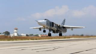 A file picture taken on 3 October 2015 shows a Russian Sukhoi Su-24 bomber taking off from the Hmeimim airbase in the Syrian province of Latakia