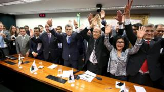PMDB leaders celebrate after announcing they are withdrawing support for President Rousseff's ruling coalition during National Executive Meeting in Brasilia. March 29, 2016