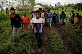 Friend and family carry a coffin with the remains of Jakelin Caal, a 7-year-old girl who handed herself in to U.S. border agents earlier this month and died after developing a high fever while in the custody of U.S. Customs and Border Protection, during her funeral at her home village of San Antonio Secortez, in Guatemala December 25, 2018.