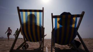 Sunbathers on chairs