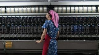 A woman works in the Kim Jong Suk Silk Factory on August 21, 2018 in Pyongyang, North Korea
