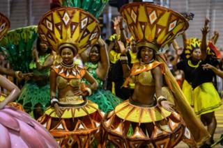 "Performers from ""Cape Town Carnival"" of South Africa take part in the annual Lunar New Year parade in the Kowloon district of Hong Kong on February 5, 2019, to mark the Year of the Pig."