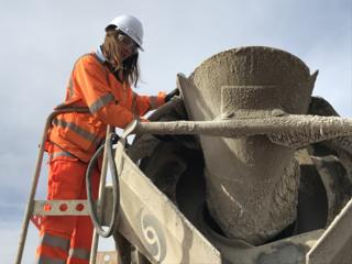 Emily Burridge inspects a batch of concrete