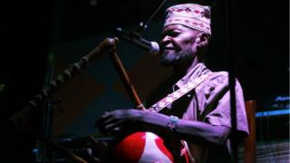 enya-born singer and musician Ayub Ogada, 60, performs in concert in Nairobi, Kenya Sunday, Dec. 11, 2016. Born in Mombasa, Kenya, Ogada uses the traditional nyatiti, an eight-stringed lyre played by the Luo people of Western Kenya, and his music has featured in a number of films.
