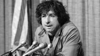 In this Dec. 6, 1973 file photo, political activist Tom Hayden, husband of Jane Fonda, tells newsmen in Los Angeles that he believes public support was partially responsible for the decision not to send him and others of the Chicago 7 to jail for contempt.
