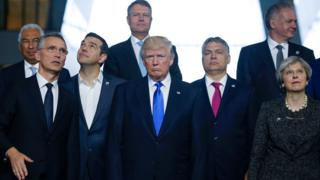 Portuguese Prime Minister Antonio Costa, NATO Secretary General Jens Stoltenberg, Greek Prime Minister Alexis Tsipras, U.S. President Donald Trump, Hungarian Prime Minister Voktor Orban and Britain's Prime Minister Theresa May pose for a family photo during a NATO summit at their new headquarters in Brussels, Belgium, May 25, 2017.